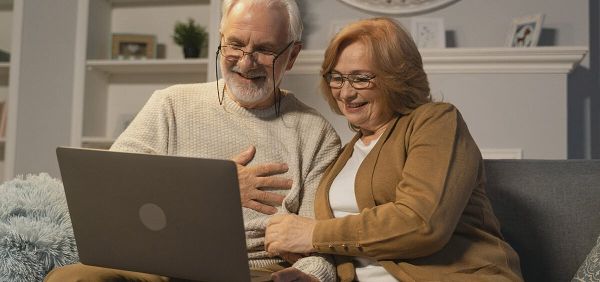 Older couple looking at their computer.